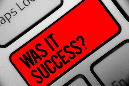 Handwriting text writing Was It Success Question. Concept meaning Happy feeling after achieving success in life Keyboard grey key silver laptop computer creative keypad netbook notebook