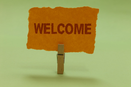 Writing note showing Welcome. Business photo showcasing Warm salutation acknowledgement for someone amiable loved thanked Nice lime colour grey shadow art work board important clip paperclip