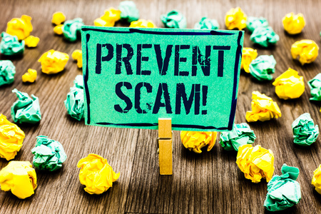 Conceptual hand writing showing Prevent Scam Motivational Call. Business photo showcasing Consumer protection fraudulent transactions Crumpled papers ideas mistakes paperclip clip objects wood