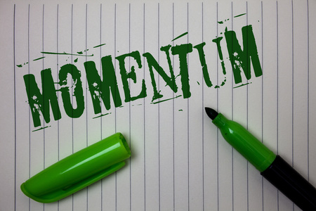 Handwriting text Momentum. Concept meaning Quantity motion in moving body Product of mass and velocity Linned paper background pen cap marker highlighter ink green drawing Banco de Imagens