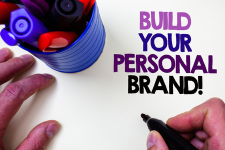 Writing note showing  Build Your Personal Brand Motivational Call. Business photo showcasing creating successful company Blue pen holder white background shadow lovely message idea temple