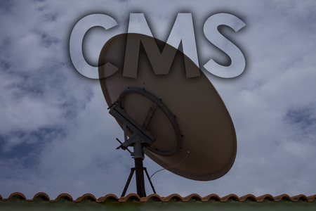 Conceptual hand writing showing Cms. Business photo text Content Management System supports modification of digital content Ideas messages television antenna cloudy sky old city house 写真素材