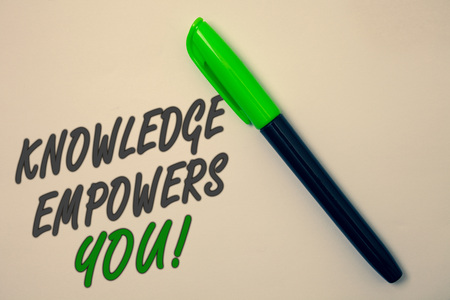 Handwriting text writing Knowledge Empowers You Call. Concept meaning Education responsible to achieve your success Ideas message beige background green pen pens marker markers intention
