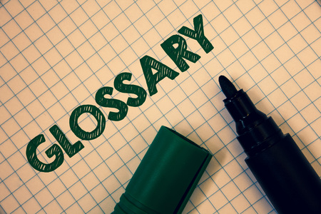 Text sign showing Glossary. Conceptual photo Alphabetical list of terms with meanings Vocabulary Descriptions Squared paper open marker ideas messages inspirational thoughts feelings