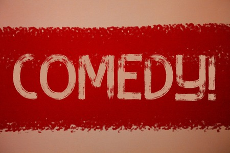 Text sign showing Comedy Call. Conceptual photo Fun Humor Satire Sitcom Hilarity Joking Entertainment Laughing Ideas messages red paint painting light brown background messy intentions Stock Photo