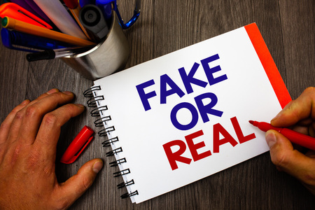 Text sign showing Fake Or Real. Conceptual photo checking if products are original or not checking quality Penholder notepad marker feelings ideas appointments information important