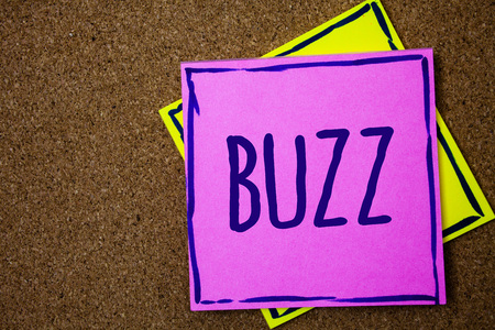 Conceptual hand writing showing Buzz. Business photo text Hum Murmur Drone Fizz Ring Sibilation Whir Alarm Beep Chime Wicker background message communicate intentions feelings thoughts Фото со стока