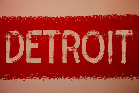 Text sign showing Detroit. Conceptual photo City in the United States of America Capital of Michigan Motown Ideas messages red paint painting light brown background messy intentions