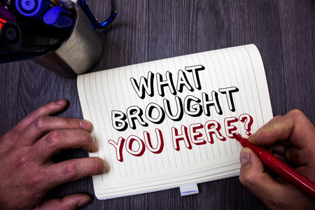 Conceptual hand writing showing What Brought You Here Question. Business photo showcasing Ambition can be obtain by determination Man hold holding red marker notebook table messages ideas Stock Photo