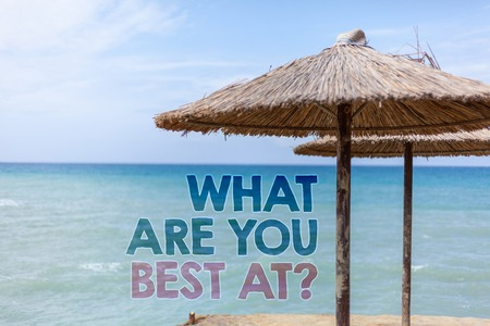 Word writing text What Are You Best At Question. Business concept for Individual creativity is a unique capability Blue beach water Thatched Straw Umbrellas Message Ideas Thoughts Reflection