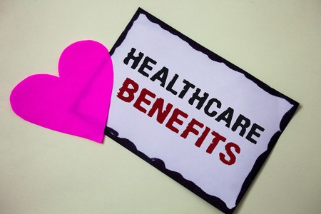 Text sign showing Healthcare Benefits. Conceptual photo it is insurance that covers the medical expenses Hart love pink white background love lovely thoughts message memories Archivio Fotografico