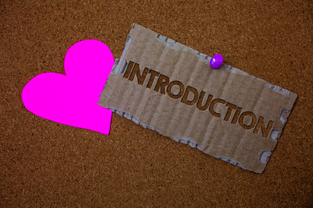 Conceptual hand writing showing Introduction. Business photo text First part of a document Formal presentation to an audience Brown old damaged paperboard ideas pink heart cork background