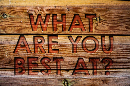 Handwriting text What Are You Best At Question. Concept meaning Individual creativity is a unique capability Wooden background vintage wood board wild message ideas intentions thoughts