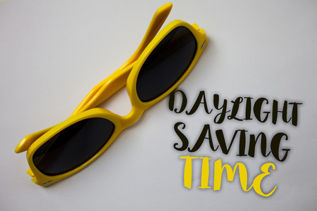 Word writing text Daylight Sayving Time. Business concept for advancing clocks during summer to save electricity Sunglass wonderful white background lovely message idea memories temple Reklamní fotografie