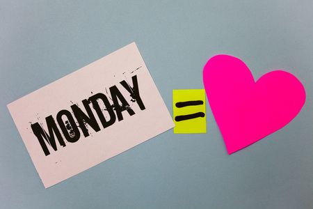 Handwriting text writing Monday. Concept meaning First day of the week Back to work Weekend is over Wakeup Early Equal symbol sticky notes heart love plane coloured background calculation