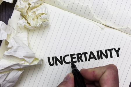 Conceptual hand writing showing Uncertainty. Business photo showcasing Unpredictability of certain situations events behavior Paper object notepad crumpled papers ideas several tries Stock Photo