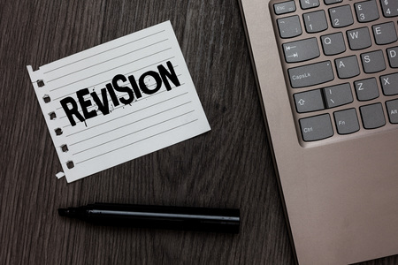 Word writing text Revision. Business concept for Rechecking Before Proceeding Self Improvement Preparation Laptop nice computer notebook netbook pen small pitch paper pen wood Archivio Fotografico