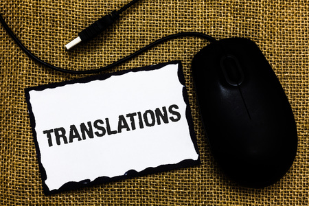 Handwriting text Translations. Concept meaning Written or printed process of translating words text voice USB black mouse art board paper ideas thoughts ideas designs mat shadow