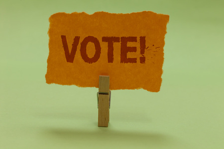 Writing note showing Vote Motivational Call. Business photo showcasing Formalized decision on important matters electing Nice lime colour grey shadow art work board important clip paperclip