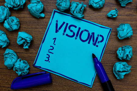 Handwriting text Vision Question. Concept meaning Company commitment describing future realistic state Cyan paper imagination idea thoughts mistakes several tries marker pen