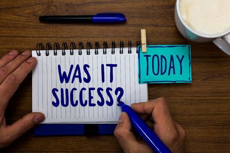 Handwriting text Was It Success Question. Concept meaning Happy feeling after achieving success in life Marker pens notepad cup milk coffee daily memories dairy clip paperclip