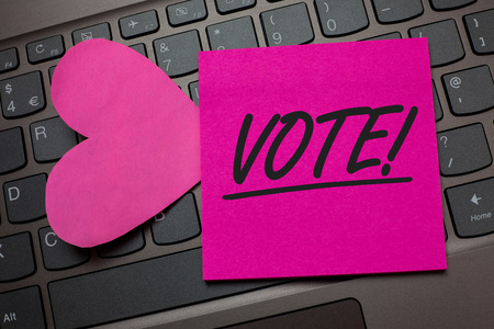 Conceptual hand writing showing Vote Motivational Call. Business photo text Formalized decision on important matters electing Keyboard grey keys pink paper love idea thought computer hart Stock Photo