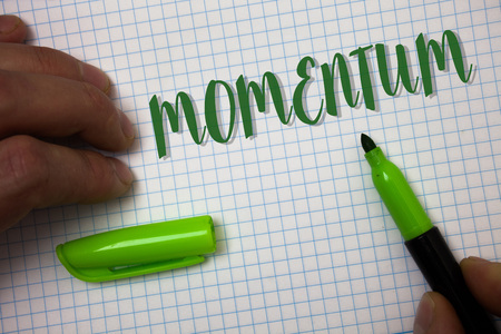 Conceptual hand writing showing Momentum. Business photo text Quantity motion in moving body Product of mass and velocity Box background pen cap marker graphs drawing office notebook