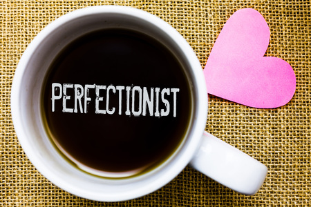 Text sign showing Perfectionist. Conceptual photo Person who wants everything to be perfect Highest standards Tea time coffee cup office typing work jute rough background love heart