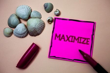 Text sign showing Maximize. Conceptual photo Increase to the greatest possible amount or degree Make larger Ink marker open cap small shells handwrittern notes artwork paper sheet