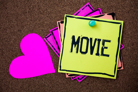 Text sign showing Movie. Conceptual photo Cinema or television film Motion picture Video displayed on screen Multi colour small sticky boarder notice board thumb pinned heart display Stock Photo
