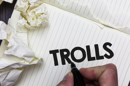 Conceptual hand writing showing Trolls. Business photo showcasing Online troublemakers posting provocative inflammatory messages Paper object notepad crumpled papers ideas several tries Reklamní fotografie
