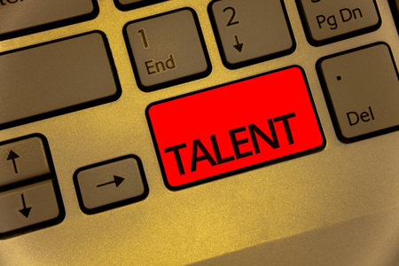 Text sign showing Talent. Conceptual photo Natural abilities of people showing specialized skills they possess Keyboard brown key yellow laptop creative computer keypad netbook notebook Imagens - 104086970