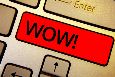 Text sign showing Wow Motivational Call. Conceptual photo Expression of somebody speechless amazed overjoyed Keyboard brown keys yellow laptop idea create computer keypad laptop