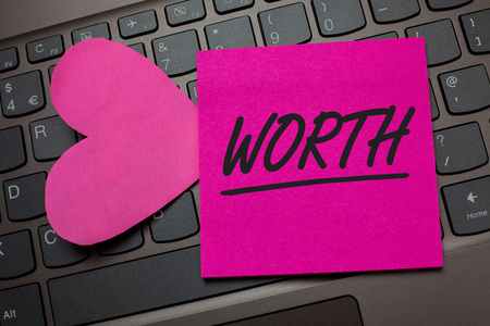 Conceptual hand writing showing Worth. Business photo text Measurement of personal and financial significance importance Keyboard grey keys pink paper love idea thought computer hart