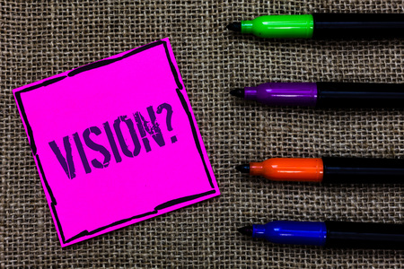 Writing note showing Vision Question. Business photo showcasing Company commitment describing future realistic state Marker pens art pink paper nice mat love thought black shadow memories