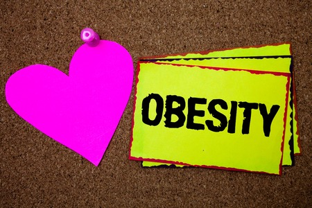 Text sign showing Obesity. Conceptual photo Medical condition Excess of body fat accumulated Health problem Border sticky remember cards love heart pinned dark brown background