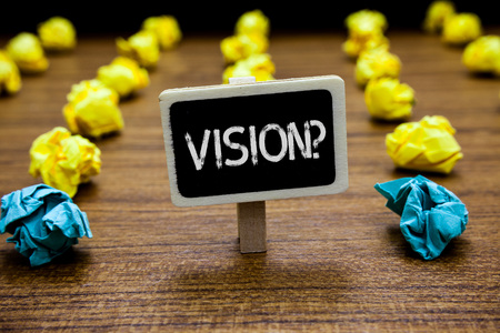 Conceptual hand writing showing Vision Question. Business photo showcasing Company commitment describing future realistic state Creative idea paper object inspiration several tries