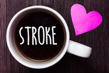 Handwriting text Stroke. Concept meaning Patients losing consciousness due to poor blood flow medical Mug coffee lovely thoughts ideas love hart romantic memories brown wood Фото со стока