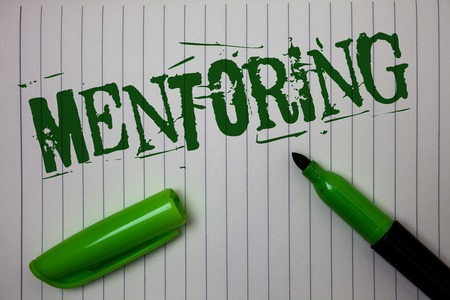 Handwriting text Mentoring. Concept meaning To give advice or support to a younger less experienced person Linned paper background pen cap marker highlighter ink green drawing