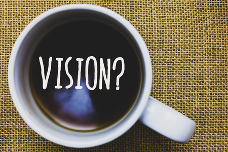 Handwriting text writing Vision Question. Concept meaning Company commitment describing future realistic state Mug coffee thoughts ideas creative inspirations nice mat black shadow