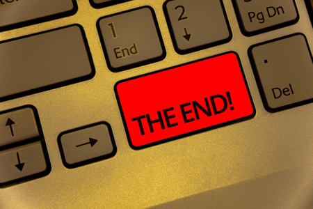 Text sign showing The End Motivational Call. Conceptual photo Conclusion of time for something ending of life Keyboard brown key yellow laptop creative computer keypad netbook notebook 스톡 콘텐츠
