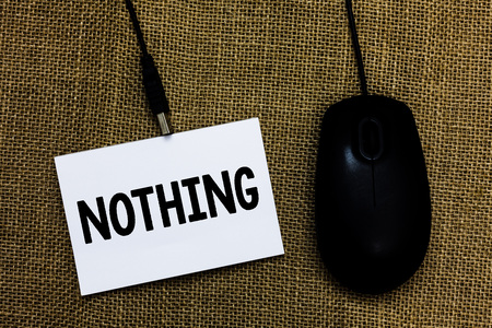 Writing note showing Nothing. Business photo showcasing Not anything No single thing or value Absence of progress Blank Sticky card type text convey message computer mouse jute background Stock Photo