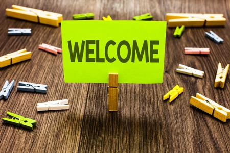 Writing note showing Welcome. Business photo showcasing Warm salutation acknowledgement for someone amiable loved thanked Clips art board creative ideas paper paperclip holding wood shadow 写真素材
