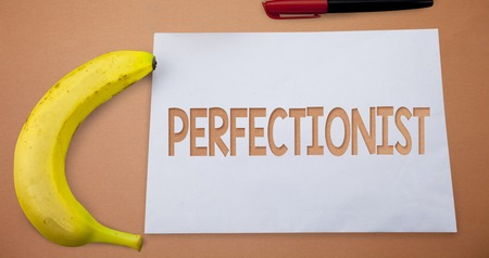 Text sign showing Perfectionist. Conceptual photo Person who wants everything to be perfect Highest standards Small paper drawing lines office work refreshment banana plane background