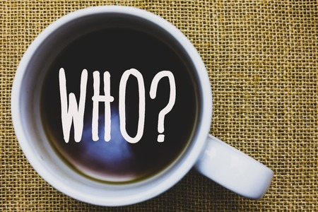 Handwriting text writing Who Question. Concept meaning Asking for specific name of someone people personality Mug coffee thoughts ideas creative inspirations nice mat black shadow