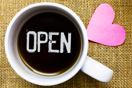 Text sign showing Open. Conceptual photo Allow things to pass through or for immediate use Contrary of closed Tea time coffee cup office typing work jute rough background love heart