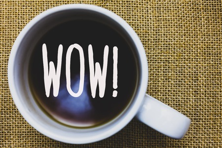 Handwriting text writing Wow Motivational Call. Concept meaning Expression of somebody speechless amazed overjoyed Mug coffee thoughts ideas creative inspirations nice mat black shadow