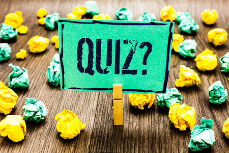 Conceptual hand writing showing Quiz Question. Business photo showcasing Short Tests Evaluation Examination to quantify your knowledge Crumpled papers ideas mistakes paperclip clip objects wood