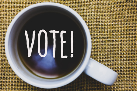 Handwriting text writing Vote Motivational Call. Concept meaning Formalized decision on important matters electing Mug coffee thoughts ideas creative inspirations nice mat black shadow
