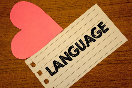 Word writing text Language. Business concept for Method of human communication Spoken Written Use Words Expression Paperpiece page heart table background typing job clerk study material